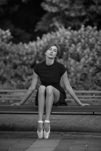 Ballerina, wooden bench and a stone ball